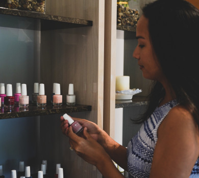woman picking out nail polish at spa